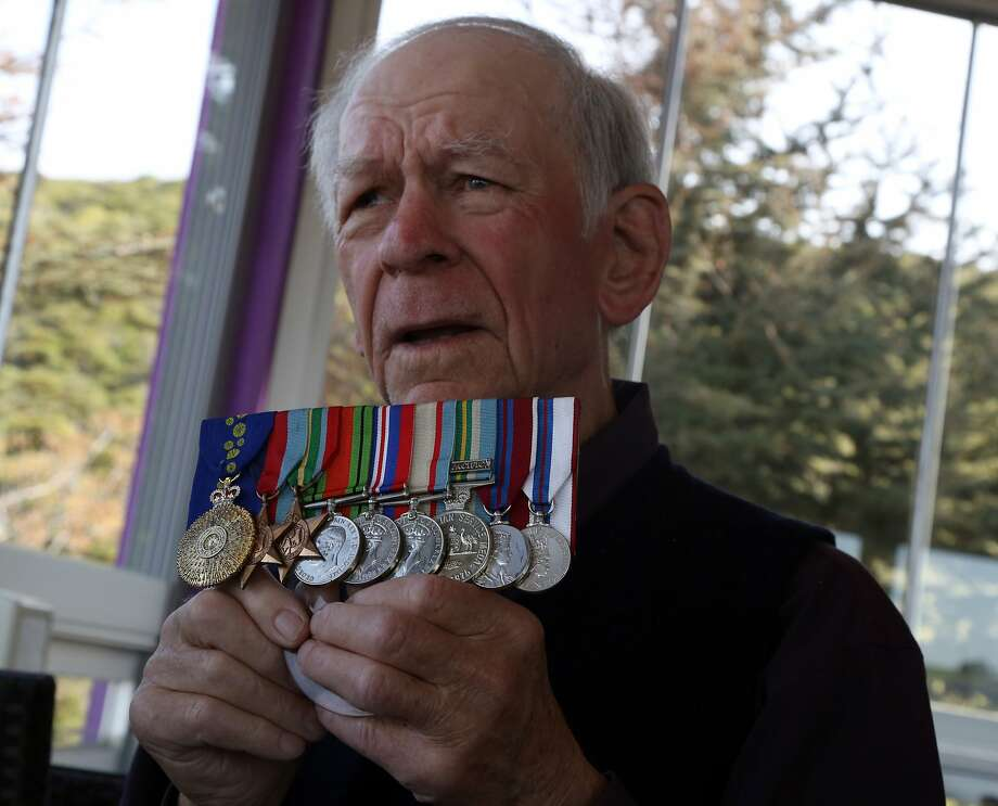 Bill Grayden shows his medals in Gallipoli, Turkey, Friday. For the first time at age 95, Grayden has come to Gallipoli, where his father stormed the beach and took a bullet through his lung during the ill-fated British-led World War I invasion. Grayden was among thousands of Australians and New Zealanders who made the pilgrimage to this distant peninsula in Turkey. Photo: Burhan Ozbilici, Associated Press