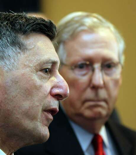 Michael Botticelli (left), director of the White House Office of National Drug Control Policy, has not consumed alcohol for 26 years. Photo: Patrick Reddy /Associated Press / The Cincinnati Enquirer