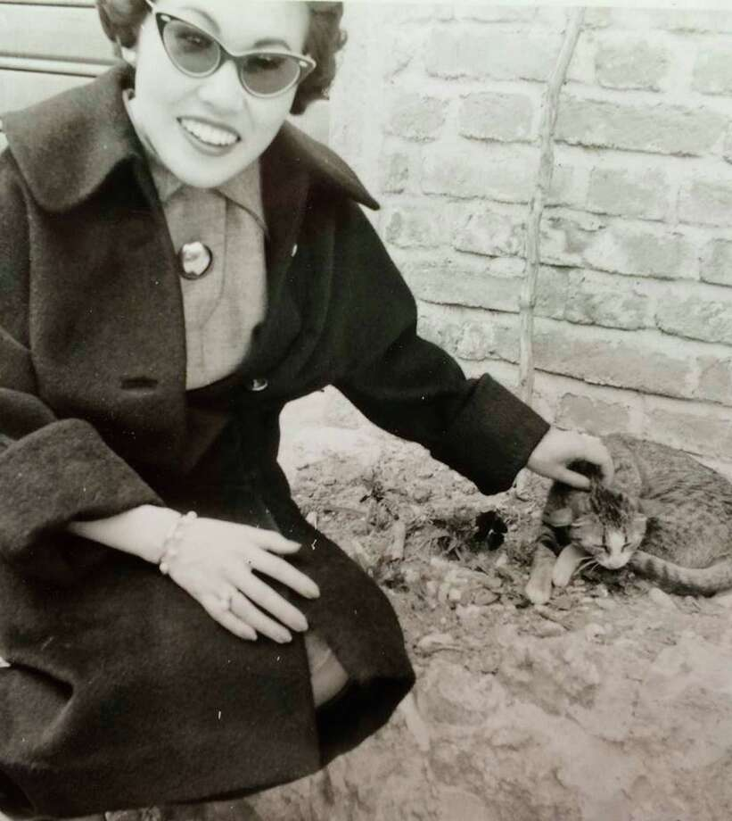 "The author's mother, Masako Connell, with the family's cat. ""My mother came from an arty family and had a strong sense of aesthetics."""
