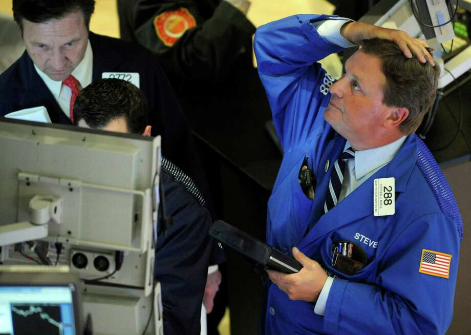 "A securities trader watches the ""flash crash"" at the New York Stock Exchange on May 6, 2010. Photo: File Photo /Associated Press / FR151332"
