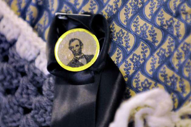 Re-enactor Lily Otto, 17, of Wilton wears a mourning button on Saturday, April 25, 2015, at the Capitol in Albany, N.Y. Lily and her family took part in the re-enactment of President Lincoln's funeral train stop in Albany. (Cindy Schultz / Times Union) Photo: Cindy Schultz / 00031417A