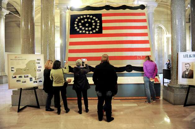 Visitors view the giant flag that was draped over President Lincoln's casket on Saturday, April 25, 2015, at the Capitol in Albany, N.Y. (Cindy Schultz / Times Union) Photo: Cindy Schultz / 00031417A