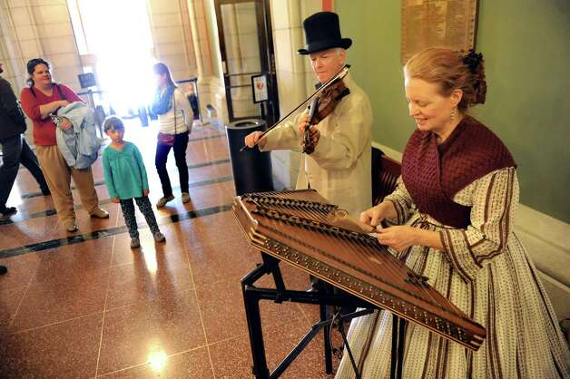 Re-enactors Anne Enslow, right, and her husband Ridley Enslow of Hoboken, N.J. play Civil War era music on Saturday, April 25, 2015, at the Capitol in Albany, N.Y. (Cindy Schultz / Times Union) Photo: Cindy Schultz / 00031417A