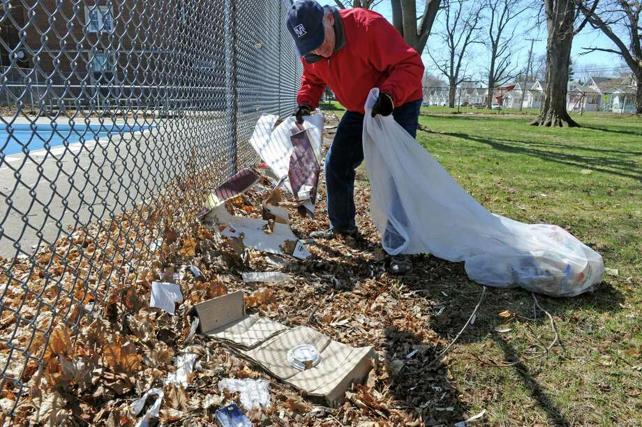 Austin Spang picks up trash at Quackenbush Park as part of Schenectady Inner City Ministry's (SICM's) Fifth Annual Day of Service on Saturday April 25, 2015 in Schenectady, N.Y. (Michael P. Farrell/Times Union) Photo: Michael P. Farrell / 00031455A