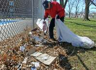 Austin Spang picks up trash at Quackenbush Park as part of Schenectady Inner City Ministry's (SICM's) Fifth Annual Day of Service on Saturday April 25, 2015 in Schenectady, N.Y. (Michael P. Farrell/Times Union)