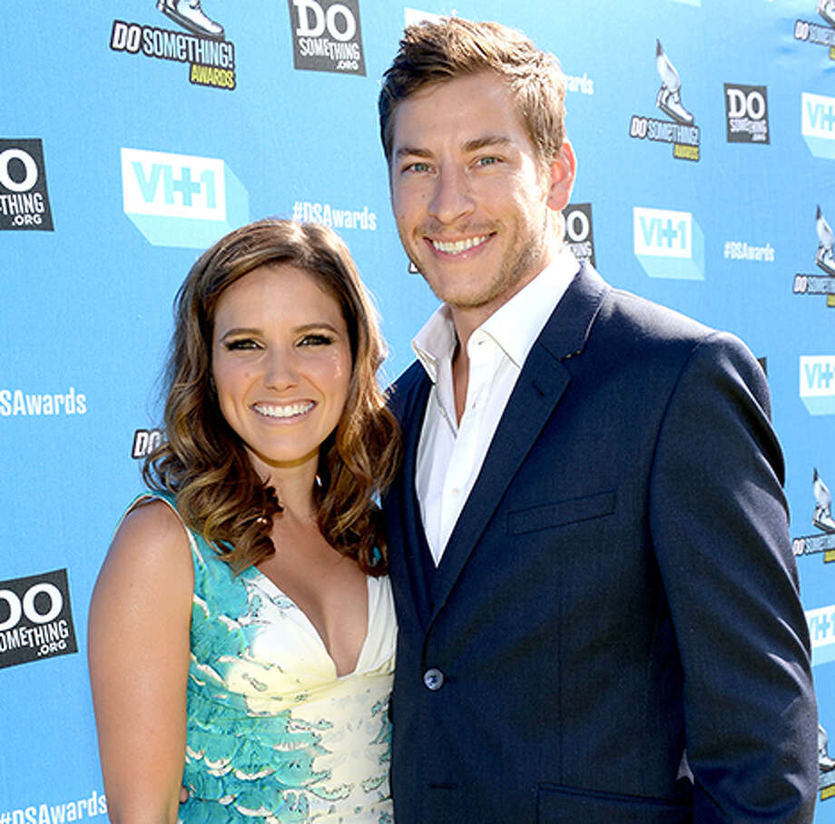 This July 31, 2013 file photo shows Sophia Bush and Dan Fredinburg arriving at the Do Something Awards at the Avalon in Los Angeles. Fredinburg, a Google executive who described himself as an adventurer, was among the hundreds who died in a massive earthquake that struck Nepal on Saturday, April 25, 2015.