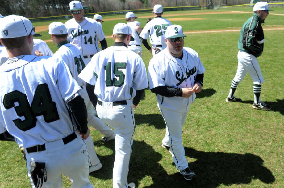 Schalmont baseball coach Chris Teta, center, with his team during their game against Troy on Saturday April 25, 2015 in Rotterdam, N.Y. (Michael P. Farrell/Times Union) Photo: Michael P. Farrell / 00031601A