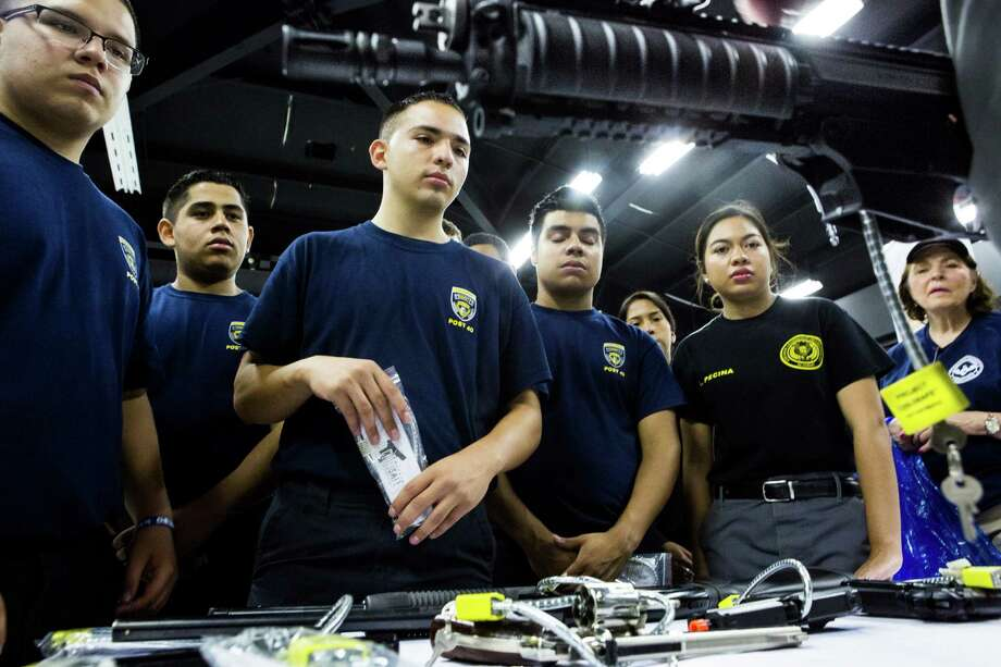 Joel Rojas, 15, Pedro Tijero, 15, Jason Chavez, 19, Raul Villacorta, 16, and Lesley Pecina, 18, were among the Sheriff Office Post 42 Explorers learning about gun safety at Saturday's event. Photo: Marie D. De Jesus, Staff / © 2015 Houston Chronicle