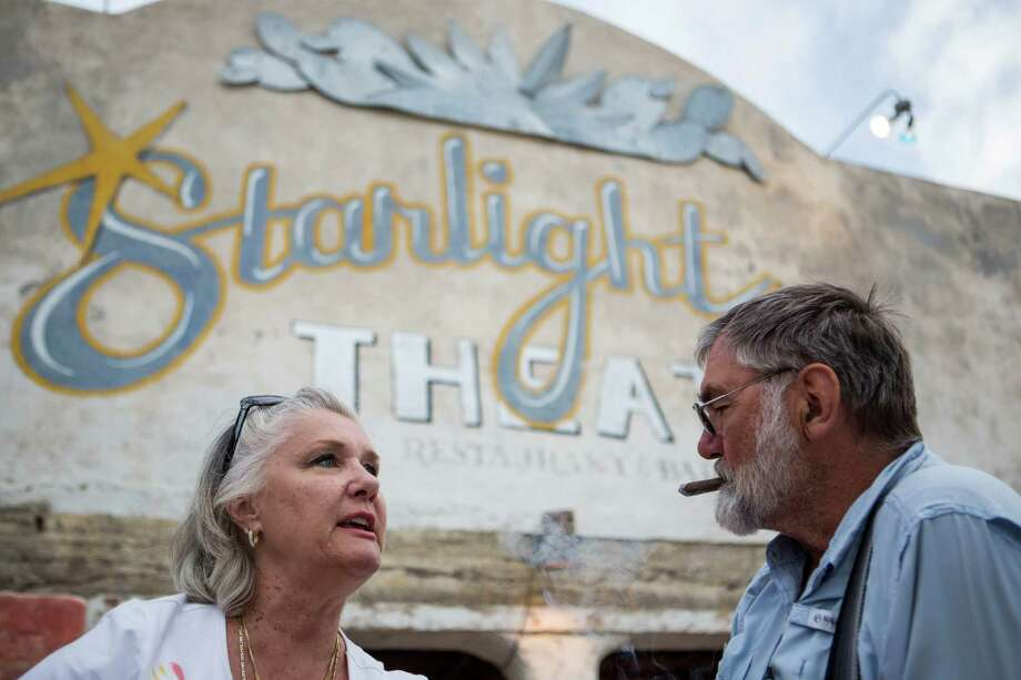 C.C. Krull talks to her husband Robert Krull as he smokes a cigar on the porch of the Starlight Theatre in Terlingua, TX on April 20, 2015.  Although they have been staying at the Study Butte RV Park, they are building a home in Terlingua because they fell in love with the place, C.C. Krull said. Photo: Carolyn Van Houten, Staff / San Antonio Express-News / 2015 San Antonio Express-News