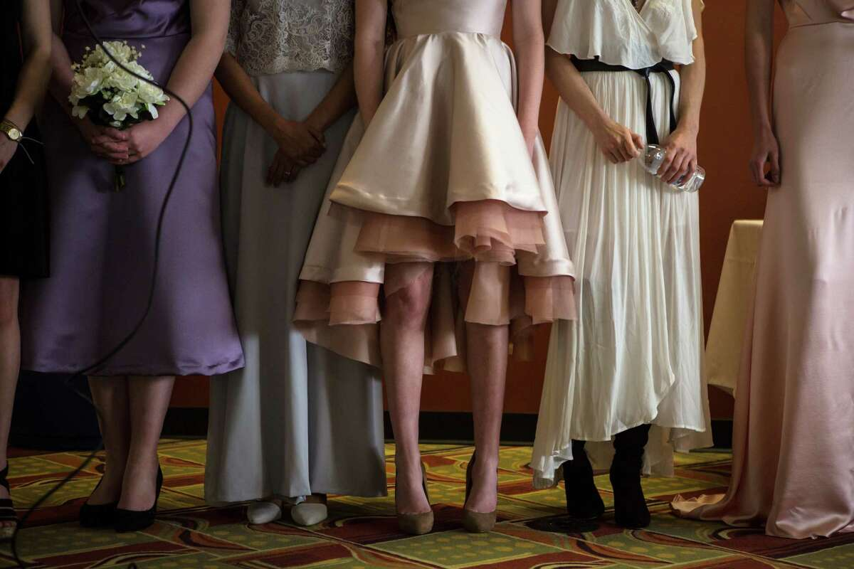Models and designers stand together at the end of the fashion show during the Fashion Industry Conference hosted by Sanford-Brown College on Saturday, April 25, 2015. The event, held to expose high school students to the fashion industry, included workshops, a fashion show and industry experts.
