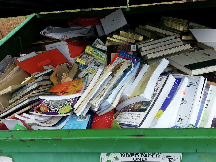"""""""One of the Green Fiber bins filled with books for recycling into cellulose insulation at Bethlehem's Earth Day Recycle Fest on April 18, which was sponsored by the Times Union."""" (Dan Rain)"""