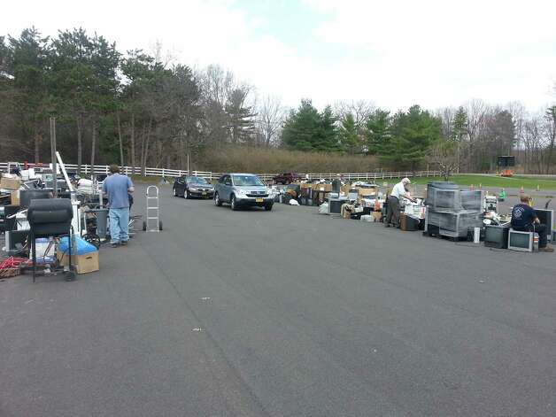 A portion of the 47,342 lbs total of electronics, appliances and scrap metal objects awaiting packing at the end of Bethlehem's Earth Day Recycle Fest on April 18, which was sponsored by the Times Union.  (Dan Rain)