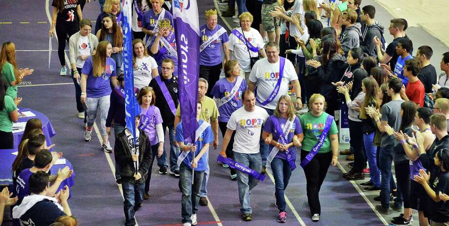 Cancer survivors and caregivers lead the 11th UAlbany Relay For Life event to support the fight against cancer Saturday April 25, 2015 at the SEFCU Arena in Albany, NY.  (John Carl D'Annibale / Times Union) Photo: John Carl D'Annibale / 00031356A