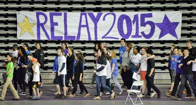 Participants walk in the 11th UAlbany Relay For Life event to support the fight against cancer Saturday April 25, 2015 at the SEFCU Arena in Albany, NY.  (John Carl D'Annibale / Times Union) Photo: John Carl D'Annibale / 00031356A