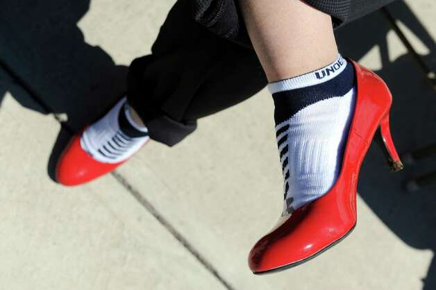 John Buntich of Troy, right, has his red pumps on as he gets ready for Walk a Mile in Her Shoes on Saturday, April 25, 2015, at Riverfront Park in Troy, N.Y. The event is a playful opportunity for men to raise their voices against sexual violence. (Cindy Schultz / Times Union) Photo: Cindy Schultz / 00031587A