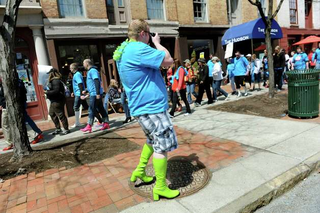 Eric Rustin of Waterford gets in the spirit as he photographs Walk a Mile in Her Shoes on Saturday, April 25, 2015, at Riverfront Park in Troy, N.Y. The event is a playful opportunity for men to raise their voices against sexual violence. (Cindy Schultz / Times Union) Photo: Cindy Schultz / 00031587A