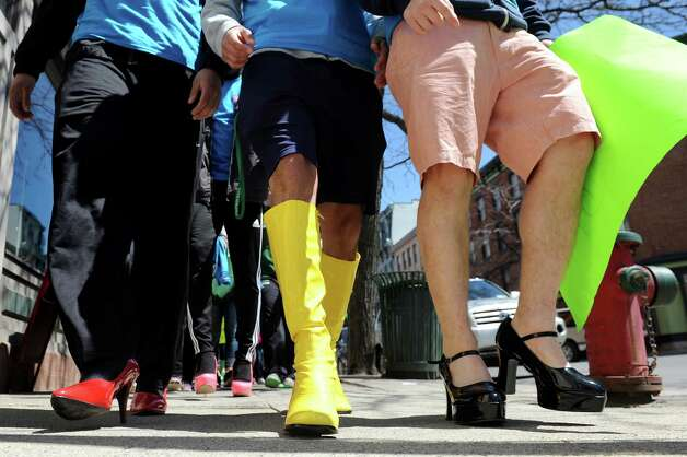 Men join forces for Walk a Mile in Her Shoes on Saturday, April 25, 2015, at Riverfront Park in Troy, N.Y. The event is a playful opportunity for men to raise their voices against sexual violence. (Cindy Schultz / Times Union) Photo: Cindy Schultz / 00031587A