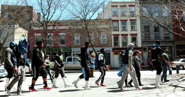 Participants take their heels downtown during Walk a Mile in Her Shoes on Saturday, April 25, 2015, in Troy, N.Y. The event is a playful opportunity for men to raise their voices against sexual violence. (Cindy Schultz / Times Union) Photo: Cindy Schultz / 00031587A