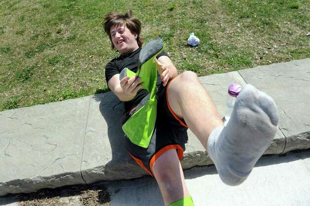Drew Gates, 17, of Troy gratefully pulls off high-heeled boots at the end of Walk a Mile in Her Shoes on Saturday, April 25, 2015, in Troy, N.Y. The event is a playful opportunity for men to raise their voices against sexual violence. (Cindy Schultz / Times Union) Photo: Cindy Schultz / 00031587A