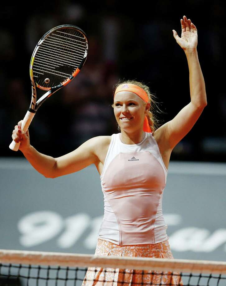 Denmark's Caroline Wozniacki reacts after beating Romania's Simona Halep in their semifinal match at the Porsche Grand Prix tennis tournament in Stuttgart, Germany, Saturday, April 25, 2015. (AP Photo/Michael Probst) ORG XMIT: PSTU111 Photo: Michael Probst / AP