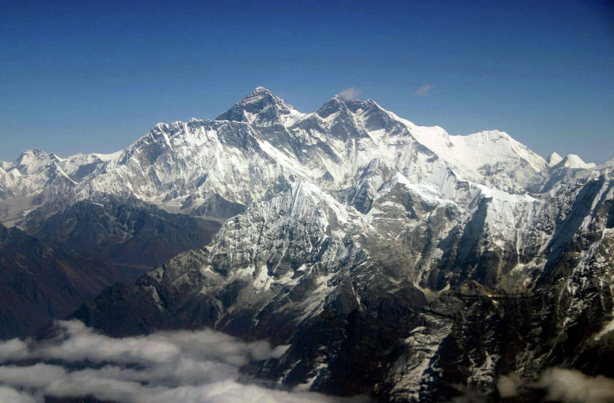 Seven Summits: highest peaks on each continent Everest As everyone knows, Mount Everest in the Himalayas is, at 29,029 feet, the highest mountain in the world. Of course, that also makes it the highest mountain in Asia.