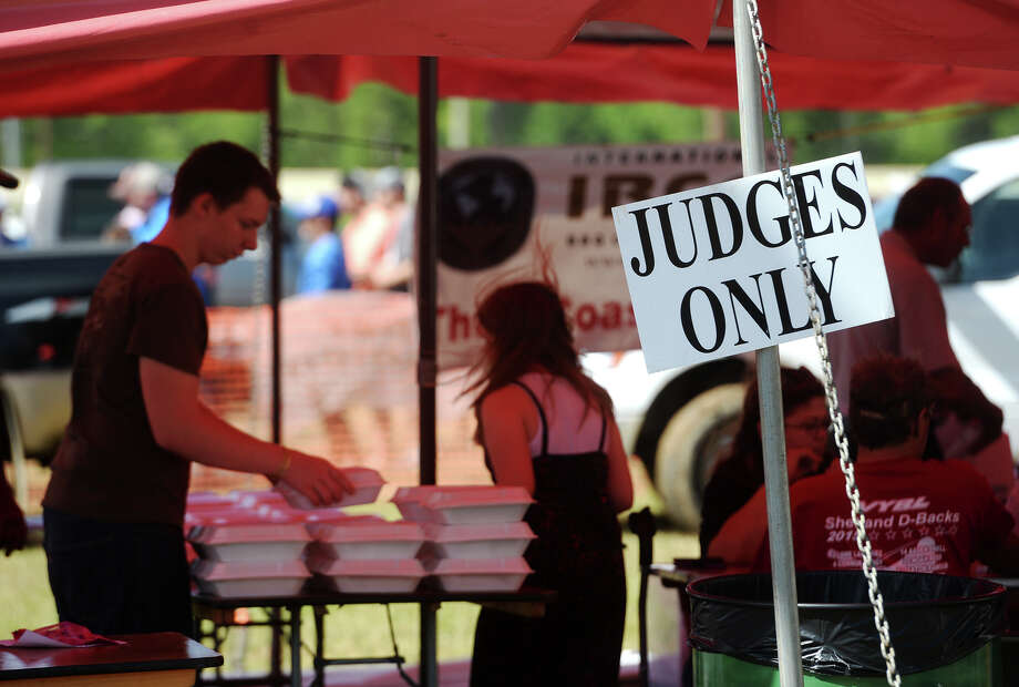 The final tasting of brisket is prepared inside the judges' tent Saturday. The Texas Barbecue Festival was held at Conn Park in Vidor from Thursday through Sunday, drawing 43 teams to compete in the International Barbeque Cookers Association-sanctioned contest. Photo taken Saturday 4/25/15 Jake Daniels/The Enterprise Photo: Jake Daniels / ©2015 The Beaumont Enterprise/Jake Daniels
