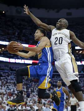 Golden State Warriors guard Stephen Curry goes to the basket against New Orleans Pelicans guard Quincy Pondexter (20) during the first half of Game 4 of a first-round NBA basketball playoff series in New Orleans, Saturday, April 25, 2015. (AP Photo/Gerald Herbert)