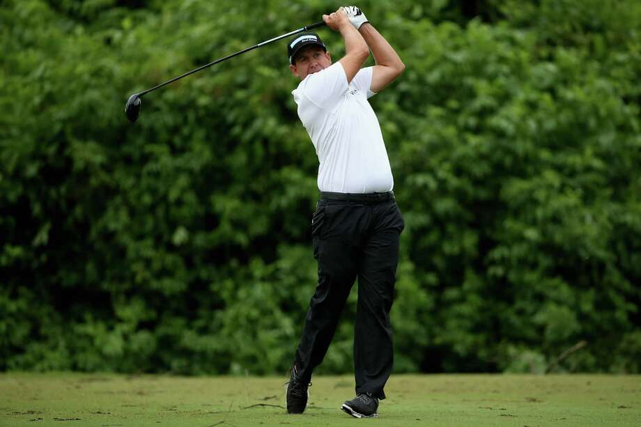 AVONDALE, LA - APRIL 25: Erik Compton tees off on the second hole during round three of the Zurich Classic of New Orleans at TPC Louisiana on April 25, 2015 in Avondale, Louisiana.  (Photo by Chris Graythen/Getty Images) ORG XMIT: 527911781 Photo: Chris Graythen / 2015 Getty Images