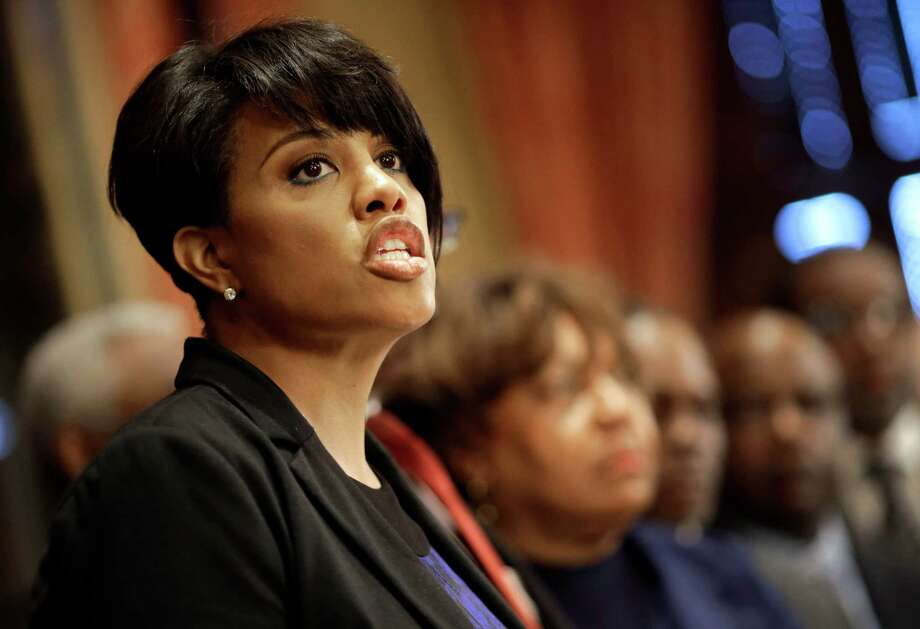 Baltimore Mayor Stephanie Rawlings-Blake speaks in front of local faith leaders at a news conference regarding the death of Freddie Gray, Friday, April 24, 2015, in Baltimore. Gray died from spinal injuries about a week after he was arrested and transported in a police van. (AP Photo/Patrick Semansky) ORG XMIT: MDPS104 Photo: Patrick Semansky / AP