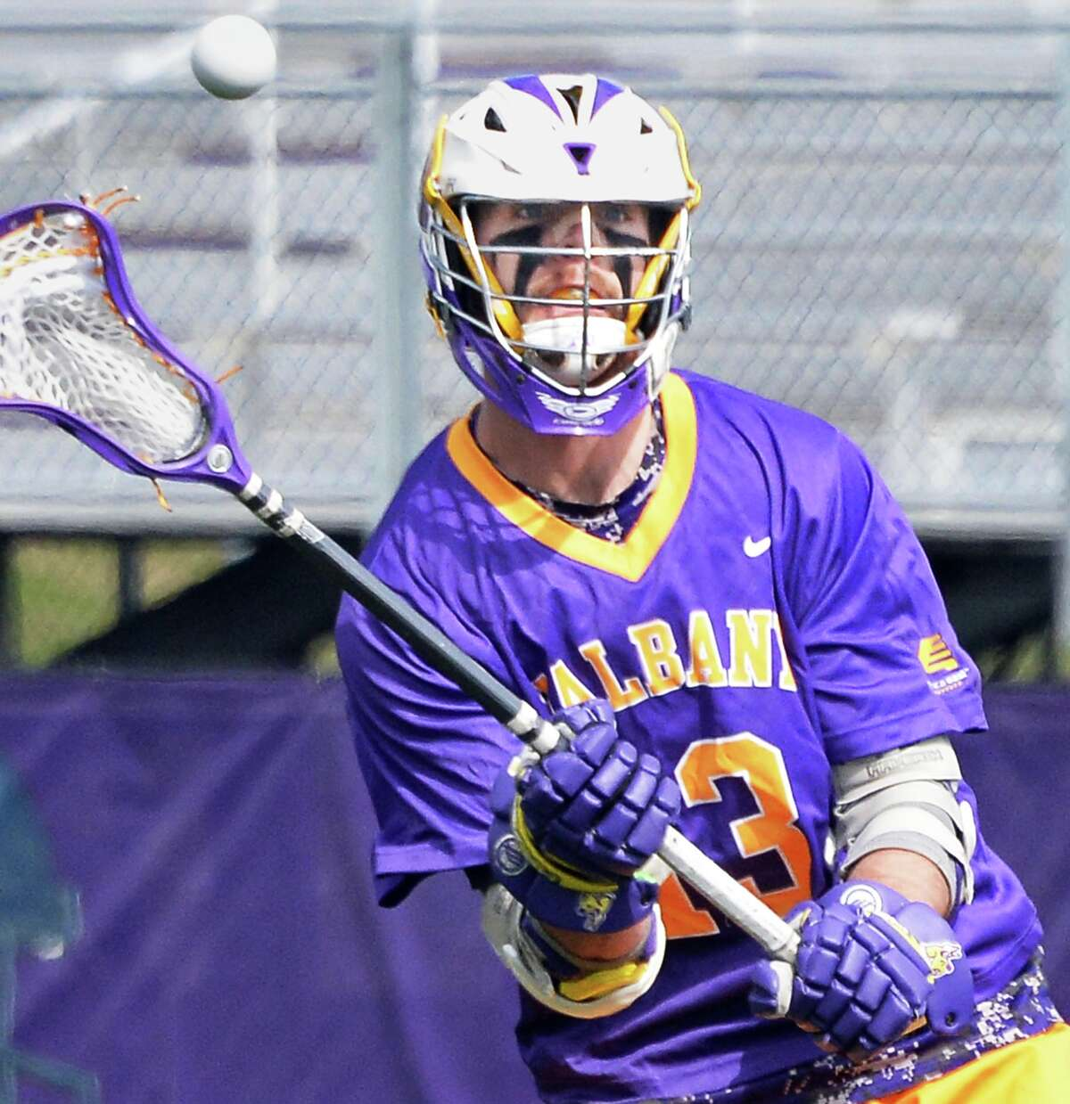 UAlbany's #13 Tim Cox fires off a pass during Saturday's game against Maryland-Baltimore County at Bob Ford Field April 25, 2015 in Albany, NY. (John Carl D'Annibale / Times Union)