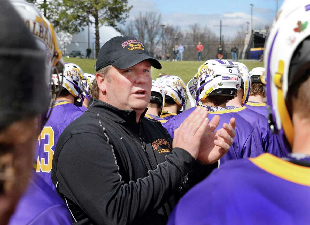 UAlbany lacrosse head coach Scott Marr with players during a time out in Saturday's game against Maryland-Baltimore County at Bob Ford Field April 25, 2015 in Albany, NY. (John Carl D'Annibale / Times Union)