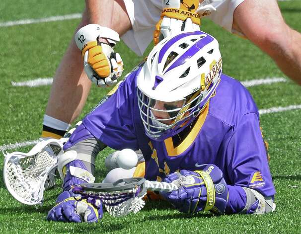 UAlbany's #5 Connor Fields fights to keep control of the ball during Saturday's game against Maryland-Baltimore County at Bob Ford Field April 25, 2015 in Albany, NY.  (John Carl D'Annibale / Times Union) Photo: John Carl D'Annibale / 00031590A
