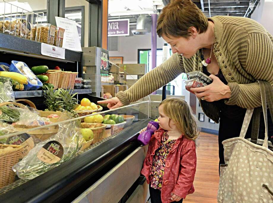Andrea Fagan of Troy and daughter Stella, 2, shop the produce market at Capital Roots' new Urban Grow Center on River St. Thursday April 16, 2015 in Troy, NY.  (John Carl D'Annibale / Times Union) Photo: John Carl D'Annibale / 00031447A