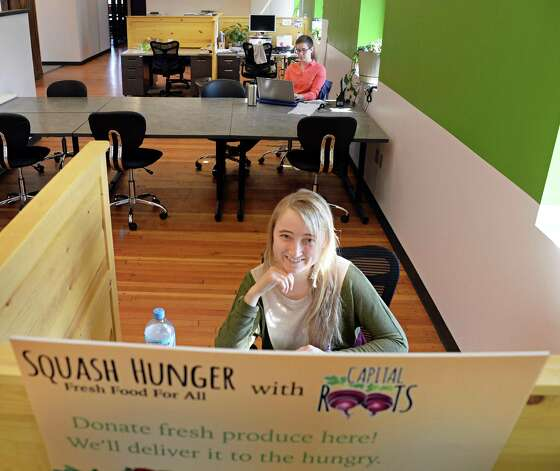 Veggie Mobile marketing intern Laura Peters in the offices of Capital Roots' new Urban Grow Center on River St. Thursday April 16, 2015 in Troy, NY.  (John Carl D'Annibale / Times Union) Photo: John Carl D'Annibale / 00031447A