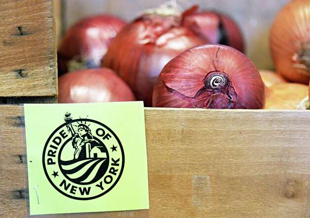 Local onions at the produce market in Capital Roots' new Urban Grow Center on River St. Thursday April 16, 2015 in Troy, NY.  (John Carl D'Annibale / Times Union) Photo: John Carl D'Annibale / 00031447A
