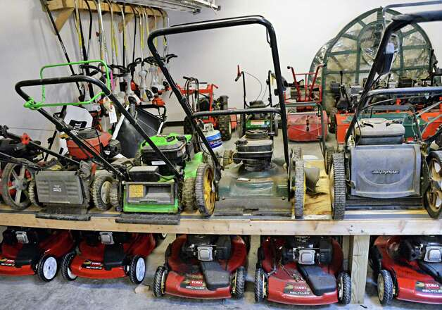 Mowers and gardening equipment for Capital Roots'  51 community gardens at their new Urban Grow Center on River St. Thursday April 16, 2015 in Troy, NY.  (John Carl D'Annibale / Times Union) Photo: John Carl D'Annibale / 00031447A
