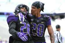 Sidney Jones (26) is congratulated by teammate Kevin King (20) after an interception and touchdown during the University of Washington football Spring Preview on Saturday, April 25, 2015 at Husky Stadium.