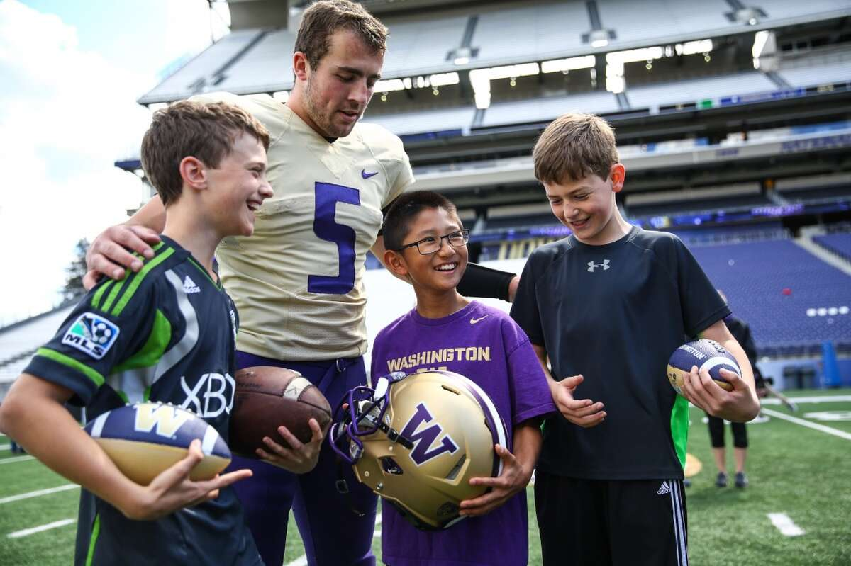 University of Washington quarterback Jeff Lindquist poses with fans during the University of Washington football Spring Preview on Saturday, April 25, 2015 at Husky Stadium. (Joshua Trujillo, seattlepi.com)
