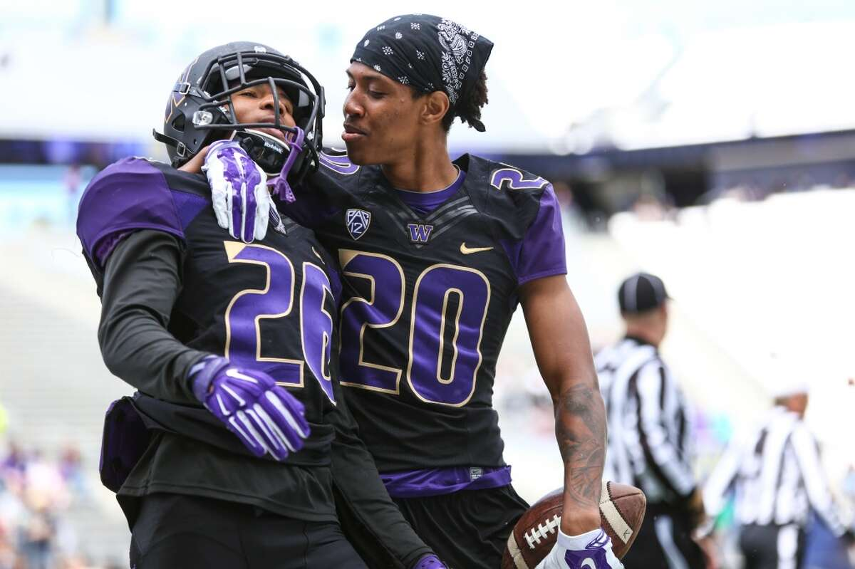Sidney Jones (26) is congratulated by teammate Kevin King (20) after an interception and touchdown during the University of Washington football Spring Preview on Saturday, April 25, 2015 at Husky Stadium. (Joshua Trujillo, seattlepi.com)