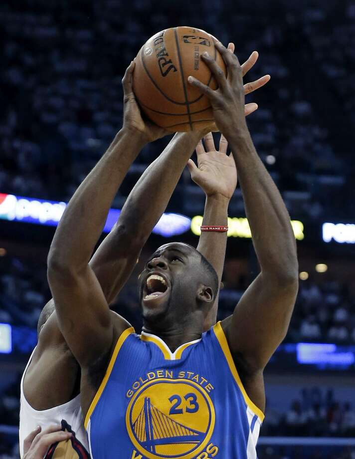 Golden State Warriors forward Draymond Green (23) goes to the basket against New Orleans Pelicans guard Quincy Pondexter during the first half of Game 4 of a first-round NBA basketball playoff series in New Orleans, Saturday, April 25, 2015. (AP Photo/Gerald Herbert) Photo: Gerald Herbert, Associated Press