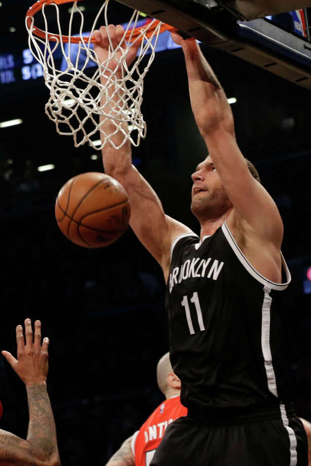 Brooklyn Nets center Brook Lopez dunks during the first half in Game 3 of a first-round NBA basketball playoff series Atlanta Hawks, Saturday, April 25, 2015, at  New York.  (AP Photo/Mary Altaffer) ORG XMIT: NYMA102 Photo: Mary Altaffer / AP