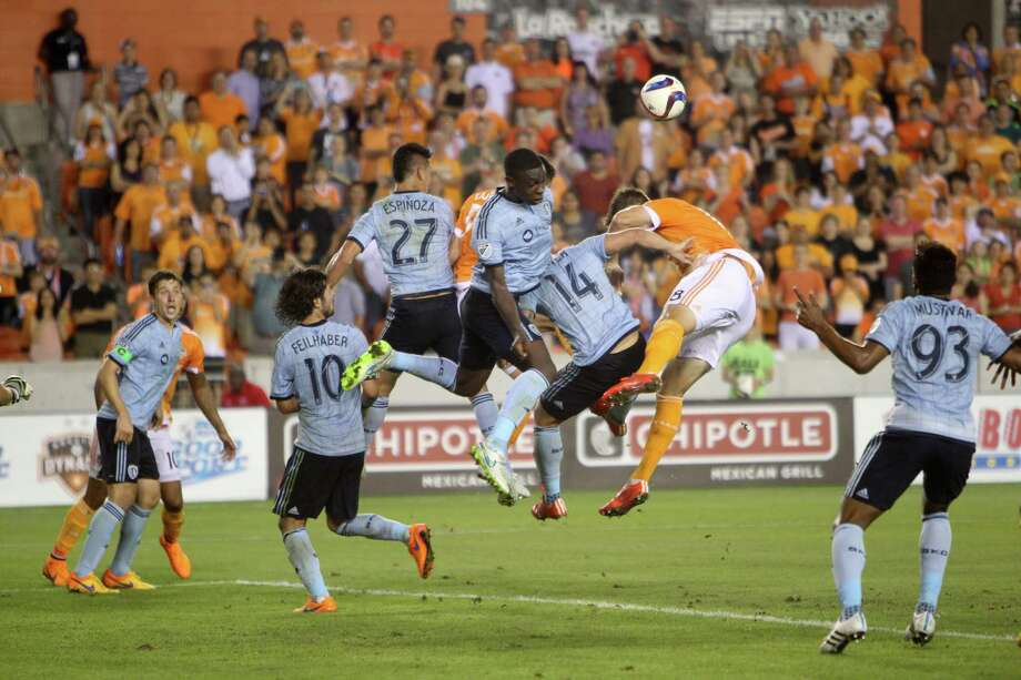 Houston Dynamo and Sporting KC fight to get position on a Dynamo corner kick during the second half of a game played at BBVA Compass Saturday, April 25, 2015, in Houston. Photo: Gary Coronado, Houston Chronicle / © 2015 Houston Chronicle