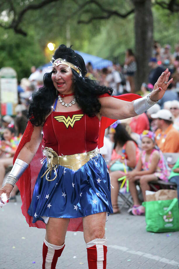 Wonder Woman walks through Alamo Plaza during the Flambeau Parade in downtown San Antonio on April 25, 2015. Photo: Tom Reel / San Antonio Express-News