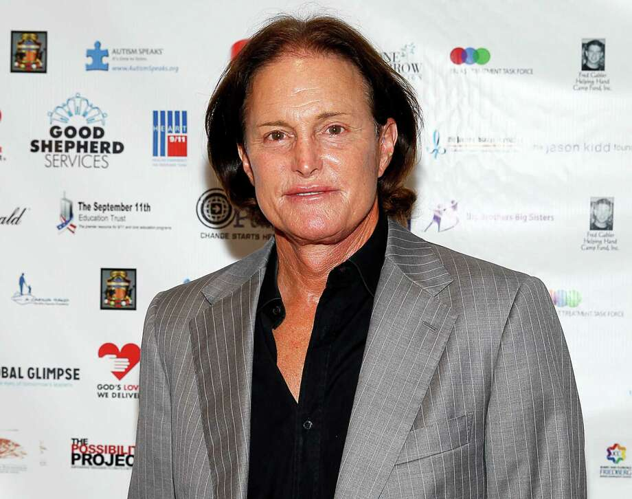 FILE - In this Sept. 11, 2013 file photo, former Olympic athlete Bruce Jenner arrives at the Annual Charity Day hosted by Cantor Fitzgerald and BGC Partners, in New York. ABC 's Diane Sawyer will interview the former Olympic champion and patriarch of the Kardashian television clan in a two-hour interview airing on Friday, April 24. (Photo by Mark Von Holden/Invision/AP, File) ORG XMIT: NYET312 Photo: Mark Von Holden / Invision