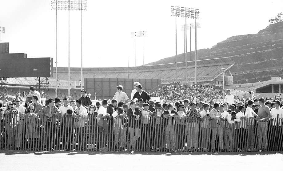 A large crowd outside of Candlestick park gathers to watch SCCA races on August 8, 1965 Photo: Bob Campbell, San Francisco Chronicle / ONLINE_YES