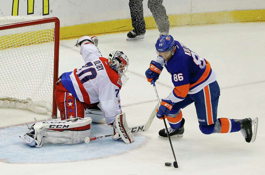 New York Islanders left wing Nikolay Kulemin (86) skates around Washington Capitals goalie Braden Holtby (70) to score the go-ahead goal during the third period in Game 6 in the first round of the NHL hockey Stanley Cup playoffs, Saturday, April 25, 2015, in Uniondale, N.Y. The Islanders won 3-1 to tie the best-of-seven games series at 3-3. (AP Photo/Julie Jacobson) ORG XMIT: NYJJ111 Photo: Julie Jacobson / AP