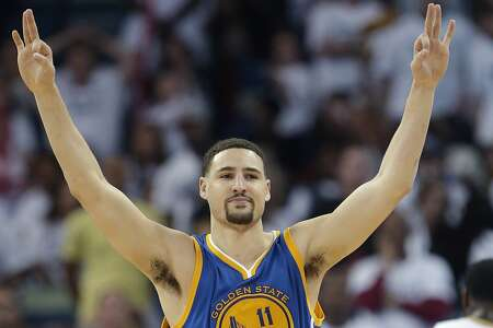 Golden State Warriors guard Klay Thompson (11) reacts after hitting a 3-point basket during the second half of Game 4 of a first-round NBA basketball playoff series against the New Orleans Pelicans in New Orleans, Saturday, April 25, 2015. The Warriors won 109-98 to sweep the series. (AP Photo/Gerald Herbert)