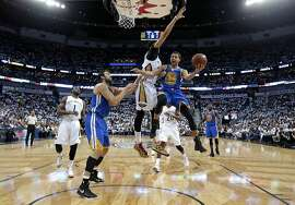 Golden State Warriors guard Stephen Curry (30) goes to the basket against New Orleans Pelicans forward Anthony Davis during the second half of Game 4 of a first-round NBA basketball playoff series in New Orleans, Saturday, April 25, 2015. The Warriors won 109-98 to sweep the series. (AP Photo/Gerald Herbert)