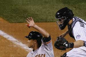 Giants beat Rockies on Panik's squeeze bunt in 11th - Photo