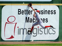 Brendan Satran falls short of stopping a home run during Saturday's game against Incarnate Word. The Lamar Cardinals hosted the Incarnate Word Cardinals at Vincent-Beck Stadium on Saturday afternoon. Photo taken Saturday 4/25/15 Jake Daniels/The Enterprise